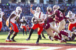 Miami running back DeeJay Dallas (13) scores against Florida State in the first half of an NCAA college football game in Tallahassee, Fla., Saturday, Nov. 2, 2019. (AP Photo/Mark Wallheiser)