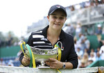 Australia's Ashley Barty poses with the trophy after beating Germany's Julia Goerges during the final match of the Nature Valley Classic at Edgbaston Priory Club in Birmingham, England, Sunday June 23, 2019. (Tim Goode/PA via AP)