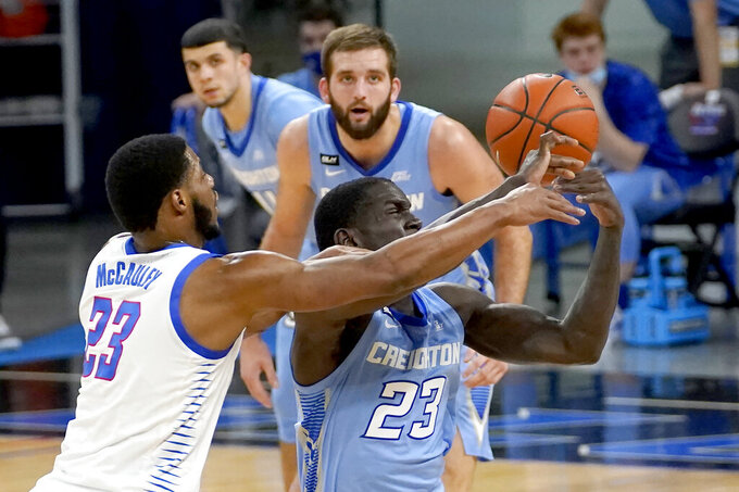 Creighton's Damien Jefferson, right, steals the ball from DePaul's Courvoisier McCauley during the first half of an NCAA college basketball game Saturday, Jan. 30, 2021, in Chicago. (AP Photo/Charles Rex Arbogast)