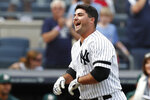 New York Yankees' Mike Ford celebrates hitting a pinch-hit, walk-off home run after a baseball game against the Oakland Athletics, Sunday, Sept. 1, 2019, in New York. (AP Photo/Kathy Willens)