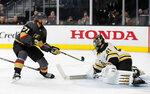 Boston Bruins goaltender Jaroslav Halak (41) blocks a shot by Vegas Golden Knights center William Karlsson (71) during the second period of an NHL hockey game Wednesday, Feb. 20, 2019, in Las Vegas. (AP Photo/John Locher)
