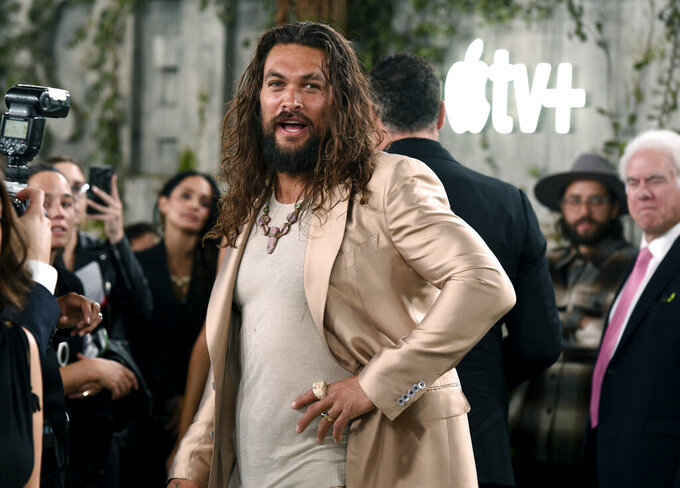 """FILE - Jason Momoa, a cast member in the Apple TV+ series """"See,"""" arrives at the premiere on Oct. 21, 2019, in Los Angeles. Momoa turns 42 on Aug. 1. (Photo by Chris Pizzello/Invision/AP, File)"""