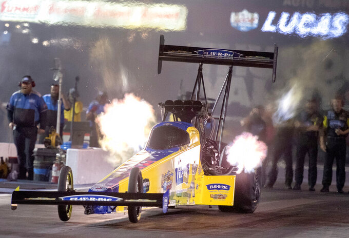 Brittany Force takes off from the starting line in Top Fuel at the NHRA Thunder Valley Nationals drag races Friday, Oct. 15, 2021, at Bristol Dragway in Bristol, Tenn. (David Crigger/Bristol Herald Courier via AP)