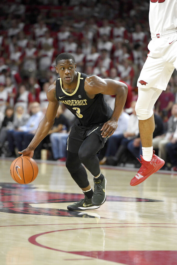 Vanderbilt guard Maxwell Evans (3) tries to get past an Arkansas defender during the second half of an NCAA college basketball game, Tuesday, Feb. 5, 2019 in Fayetteville, Ark. (AP Photo/Michael Woods)