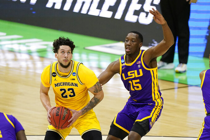 Michigan forward Brandon Johns Jr. (23) drive to the basket past LSU guard Aundre Hyatt (15) during the first half of a second-round game in the NCAA men's college basketball tournament at Lucas Oil Stadium Monday, March 22, 2021, in Indianapolis. (AP Photo/Darron Cummings)