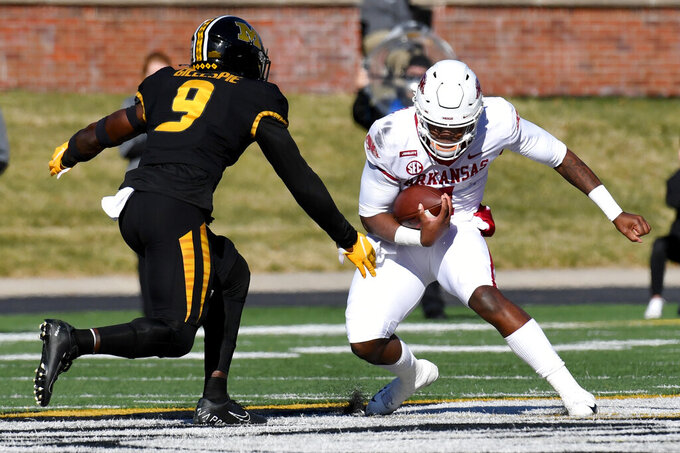 Arkansas quarterback KJ Jefferson, right, scrambles as Missouri safety Tyree Gillespie (9) defends during the first half of an NCAA college football game Saturday, Dec. 5, 2020, in Columbia, Mo. (AP Photo/L.G. Patterson)