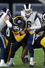 Los Angeles Rams quarterback Jared Goff (16) is sacked by Pittsburgh Steelers outside linebacker T.J. Watt (90) during the first half of an NFL football game in Pittsburgh, Sunday, Nov. 10, 2019. (AP Photo/Keith Srakocic)