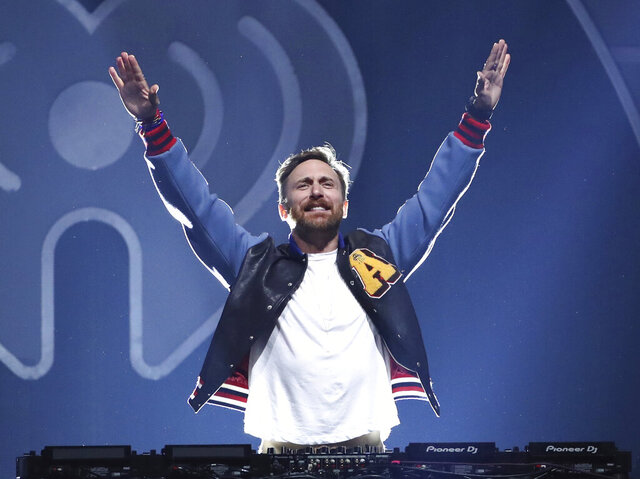 FILE - This Sept. 22, 2017 file photo shows DJ-producer David Guetta performing at the 2017 iHeartRadio Music Festival in Las Vegas. When hundreds of artists started singing from their living rooms when the coronavirus pandemic hit, the Grammy-winning DJ-producer still wanted to perform in front of a live audience. So the hitmaker set up shop at Icon Brickell in downtown Miami, performing outdoors for 90 minutes as 8,000 locals danced along from their balconies during the feel-good moment last month. Now, he's launching his second United At Home event at an undisclosed location in New York on Saturday to connect with fans and raise money for health care workers and virus relief efforts. (Photo by John Salangsang/Invision/AP, File)
