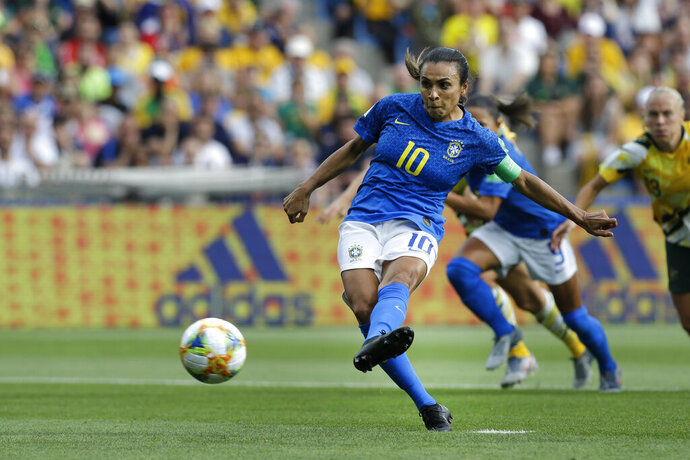 Brazil's Marta shoots a penalty kick to score the opening goal during the Women's World Cup Group C soccer match between Australia and Brazil at Stade de la Mosson in Montpellier, France, Thursday, June 13, 2019. (AP Photo/Claude Paris)