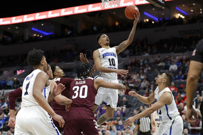 Indiana State's Christian Williams (10) heads to the basket during the first half of an NCAA college basketball game against Missouri State in the quarterfinal round of the Missouri Valley Conference men's tournament Friday, March 6, 2020, in St. Louis. (AP Photo/Jeff Roberson)