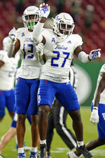 Tulsa safety Lamar Mullins (13) celebrates with safety Daiquain Jackson after Mullins recovered a fumble by South Florida during the first half of an NCAA college football game Friday, Oct. 23, 2020, in Tampa, Fla. (AP Photo/Chris O'Meara)