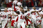 Miami of Ohio defensive lineman Cam Turner (52) leads the team onto the field in celebration after the Mid-American Conference championship NCAA college football game against Central Michigan, Saturday, Dec. 7, 2019, in Detroit. (AP Photo/Carlos Osorio)