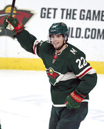 Minnesota Wild's Kevin Fiala (22) celebrates his goal against the Arizona Coyotes during the first period of an NHL hockey game Thursday, Nov. 14, 2019, in St. Paul, Minn. (AP Photo/Hannah Foslien)