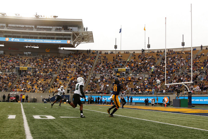 California wide receiver Jeremiah Hunter (10) catches a touchdown pass against Sacramento State safety Davion Ross (24) during the first half of an NCAA college football game on Saturday, Sept. 18, 2021, in Berkeley, Calif. (AP Photo/Jed Jacobsohn)