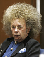 """FILE - In this May 23, 2005 file photo music producer Phil Spector appears during his trial at the Los Angeles Superior Court in Los Angeles.   Spector, the eccentric and revolutionary music producer who transformed rock music with his """"Wall of Sound"""" method and who was later convicted of murder, died Saturday, Jan. 16, 2021, at age 81. (AP Photo/Damian Dovarganes, File)"""