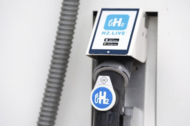 In this Monday June 8, 2020 photo a nozzle valve is attached to the dispenser of a hydrogen filling station in Dresden Germany.  The German government is to agree its national hydrogen strategy for the coming decades, part of a plan to reduce the country's dependence on fossil fuels. (Sebastian Kahnert/dpa via AP)
