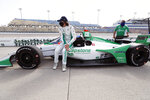 Colton Herta sits on his car during qualifying for an IndyCar Series auto race Friday, July 17, 2020, at Iowa Speedway in Newton, Iowa. (AP Photo/Charlie Neibergall)