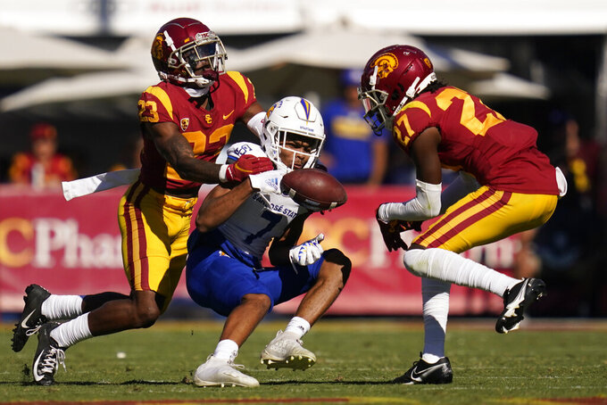 San Jose State wide receiver Charles Ross (7) can't hold on to a pass while defended by Southern California cornerback Joshua Jackson Jr. (23) and safety Calen Bullock (27) during the second half of an NCAA college football game Saturday, Sept. 4, 2021, in Los Angeles. (AP Photo/Ashley Landis)