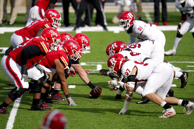 The Maryland offense lines up agains the Rutgers defense prior to the snap during the first half of an NCAA college football game, Saturday, Dec. 12, 2020, in College Park, Md. (AP Photo/Julio Cortez)