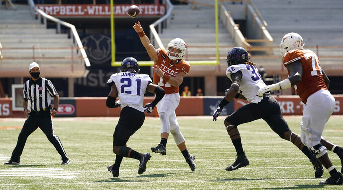 Texas quarterback Sam Ehlinger (11) throws over TCU cornerback Noah Daniels (21) during the second half of an NCAA college football game, Saturday, Oct. 3, 2020, in Austin, Texas. (AP Photo/Eric Gay)