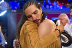 Rasheda Ali Walsh hugs her son Nico Ali Walsh after he defeated Jordan Weeks during a middleweight boxing bout Saturday, Aug. 14, 2021, near Tulsa, Okla. (Brett Rojo/Tulsa World via AP)