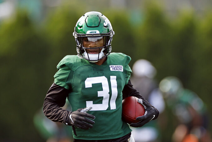 FILE - In this Aug. 22, 2020, file photo, New York Jets cornerback Bless Austin attends practice at the NFL football team's training camp in Florham Park, N.J. Austin has a strong message for anyone who thinks the Jets are weak and inexperienced at cornerback. Let's just say, he doesn't share your concerns. (AP Photo/Adam Hunger, File)