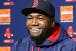 FILE - In this Sept. 27, 2016, file photo, Boston Red Sox designated hitter David Ortiz laughs during a press conference at Yankee Stadium in New York. Actor John Krasinski and the retired Red Sox slugger announced Sunday, April 12, 2020, during Krasinski's
