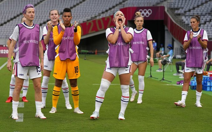 United States' players cheer their teammates before a women's soccer match against Sweden at the 2020 Summer Olympics, Wednesday, July 21, 2021, in Tokyo. (AP Photo/Ricardo Mazalan)