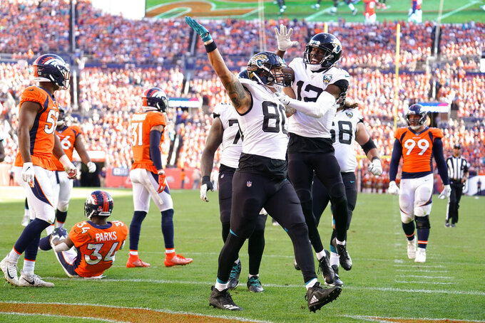 Jacksonville Jaguars tight end James O'Shaughnessy (80) reacts with teammates after scoring a touchdown during the second half of an NFL football game against the Denver Broncos, Sunday, Sept. 29, 2019, in Denver. (AP Photo/Jack Dempsey)