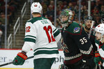 Minnesota Wild center Eric Staal (12) and Arizona Coyotes goaltender Darcy Kuemper (35) talk in the first period during an NHL hockey game, Saturday, Nov. 9, 2019, in Glendale, Ariz. (AP Photo/Rick Scuteri)