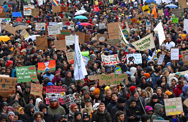 Thousands of demonstrators attend a protest climate strike ralley of the 'Friday For Future Movement' in Leipzig, Germany, Friday, Nov. 29, 2019. Cities all over the world have strikes and demonstrations for the climate during this ClimateActionDay. (AP Photo/Jens Meyer)