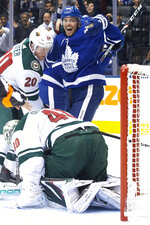 Toronto Maple Leafs' Andreas Johnsson (18) celebrates after Mitchell Marner, not seen, scored on Minnesota Wild goaltender Devan Dubnyk (40), while Wild's Ryan Suter (20) looks to the puck during the second period of an NHL hockey game Tuesday, Oct. 15, 2019, in Toronto. (Chris Young/The Canadian Press via AP)