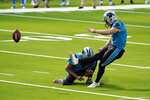 Carolina Panthers kicker Joey Slye makes a field goal during the third quarter of an NFL football game against the Los Angeles Chargers Sunday, Sept. 27, 2020, in Inglewood, Calif. (AP Photo/Alex Gallardo)
