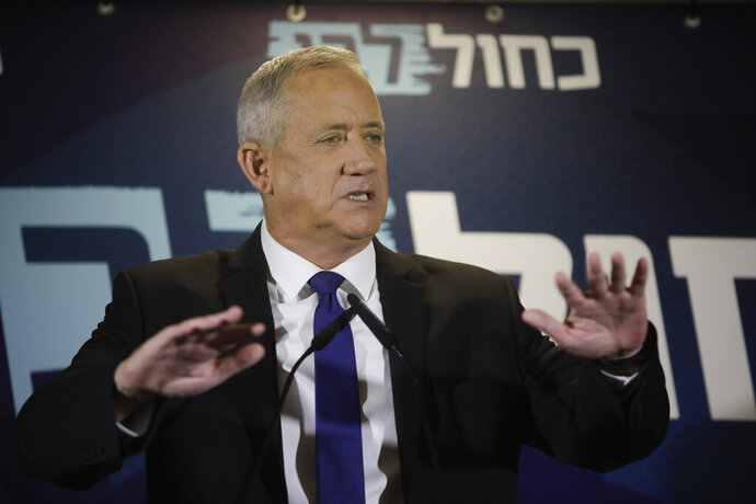 Blue and White party leader Benny Gantz delivers a statement in Tel Aviv, Thursday, Sept. 19, 2019. Benny Gantz's Blue and White has pledged not to sit in the same government as Netanyahu, as the long-serving Israeli leader is expected to face indictment in a slew of corruption scandals. (AP Photo/Sebastian Scheiner)