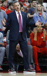 Ohio State head coach Chris Holtmann reacts to a referee's call during the first half of an NCAA college basketball game against Minnesota Thursday, Jan. 23, 2020, in Columbus, Ohio. (AP Photo/Jay LaPrete)