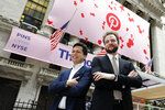 Pinterest co-founder & CEO Ben Silbermann, left, and fellow co-founder and chief product officer Evan Sharp, pose for photos outside the New York Stock Exchange, Thursday, April 18, 2019, before the company's IPO. (AP Photo/Richard Drew)
