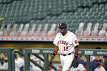Houston Astros manager Dusty Baker walks toward home plate to meet with umpires before a baseball game against the Seattle Mariners Saturday, July 25, 2020, in Houston. (AP Photo/David J. Phillip)