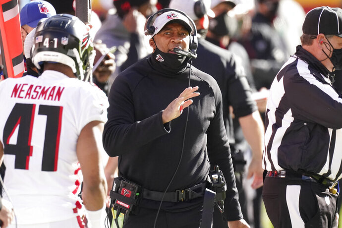 FILE - In this Dec. 27, 2020, file photo, Atlanta Falcons head coach Raheem Morris walks on the sideline during the first half of an NFL football game against the Kansas City Chiefs in Kansas City. The Los Angeles Rams have hired Raheem Morris to be their new defensive coordinator, the team announced Thursday, Jan. 21, 2021. (AP Photo/Charlie Riedel, File)