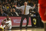 VCU head coach Mike Rhoades reacts during the first half of an NCAA college basketball game against St. Francis in Richmond, Va., Tuesday, Nov. 5, 2019. (AP Photo/Zack Wajsgras)