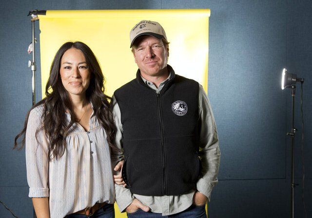 FILE - In this March 29, 2016 file photo, Joanna Gaines, left, and Chip Gaines pose for a portrait in New York to promote their home improvement show,