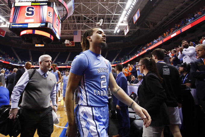 North Carolina guard Cole Anthony (2) walks off of the court following North Carolina's 81-53 loss to Syracuse in an NCAA college basketball game at the Atlantic Coast Conference tournament in Greensboro, N.C., Wednesday, March 11, 2020. (AP Photo/Ben McKeown)
