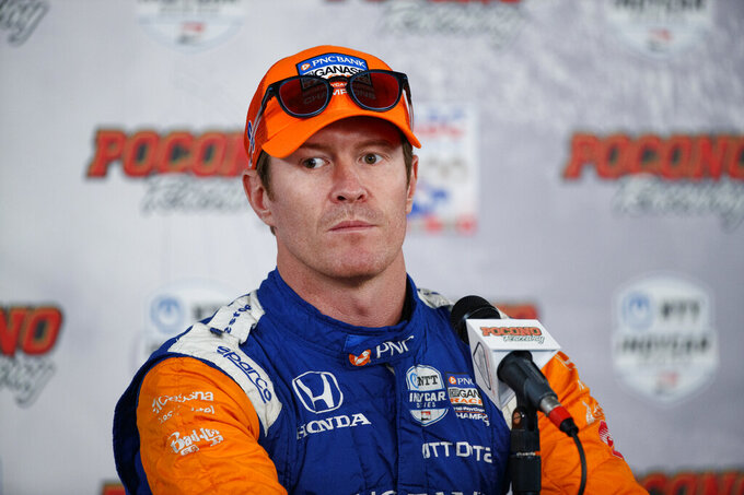 File-This Aug. 17, 2019, file photo shows Scott Dixon during a news conference for Sunday's IndyCar Series auto race at Pocono Raceway,  in Long Pond, Pa. Josef Newgarden has been the IndyCar points leader for all but one race this season and built enough of a cushion that his mindset has changed as the championship race speeds into an anticlimactic final two events of the year. Newgarden leads Team Penske teammate and Indianapolis 500 winner Simon Pagenaud by 38 points, while Alexander Rossi is 46 points behind. Five-time and reigning series champion Dixon is still mathematically in the hunt, but a mechanical issue last week at Gateway dropped him to 70 points behind Newgarden.  (AP Photo/Matt Slocum, File)