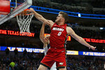 FILE - In this Dec. 14, 2019, file photo, Miami Heat forward Meyers Leonard (0) dunks on Dallas Mavericks forward Kristaps Porzingis, obscured at rear, during the first half of an NBA basketball game in Dallas. Jusuf Nurkic is back and healthy. So are Zach Collins, Meyers Leonard, Giannis Antetokounmpo, Anthony Davis and plenty of others. If the four-month NBA shutdown had a silver lining, it's that a lot of ailing players got well.  (AP Photo/Michael Ainsworth, File)