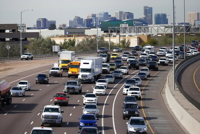 FILE - In this Jan. 24, 2020 file photo, early rush hour traffic rolls along I-10 in Phoenix. The U.S. government's road safety agency is offering a smartphone app that will alert drivers if their vehicles are recalled. The National Highway Traffic Safety Administration was to roll out the app for Android and Apple phones on Thursday, Aug. 27. (AP Photo/Ross D. Franklin, File)