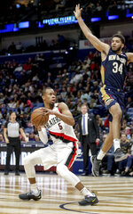 Portland Trail Blazers guard Rodney Hood (5) fakes New Orleans Pelicans guard Kenrich Williams (34) off his feet before scoring against him in the second half of an NBA basketball game in New Orleans, Friday, March 15, 2019. The Trail Blazers won 122-110. (AP Photo/Scott Threlkeld)