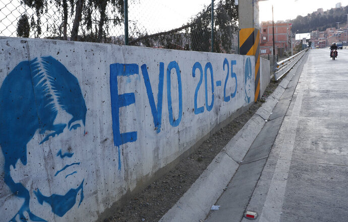 A graffiti of former Bolivian President Evo Morales adorns a wall prior to Sunday's elections, in La Paz, Bolivia, Thursday, Oct. 15, 2020. (AP Photo/Juan Karita)
