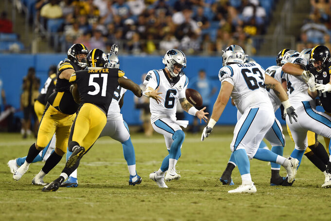 Carolina Panthers quarterback Taylor Heinicke (6) loses his grip on the ball during the second half of an NFL preseason football game against the Pittsburgh Steelers in Charlotte, N.C., Thursday, Aug. 29, 2019. (AP Photo/Mike McCarn)