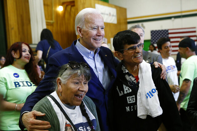 Democratic presidential candidate, former Vice President Joe Biden poses for a photo with attendees after speaking at a campaign event, Saturday, Feb. 15, 2020, at K.O. Knudson Middle School in Las Vegas. (AP Photo/Patrick Semansky)