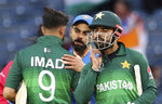 India's captain Virat Kohli, center, greets Pakistan players at the end of the Cricket World Cup match between India and Pakistan at Old Trafford in Manchester, England, Sunday, June 16, 2019. (AP Photo/Aijaz Rahi)