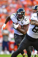 Jacksonville Jaguars running back Leonard Fournette (27) carries the ball during the second half in the NFL game against the Denver Broncos in Denver Sunday, Sept. 29, 2019.(Eric Bakke via AP)